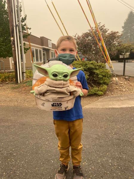 COURTESY PHOTO - Five-year-old Carver poses with the toy of The Child, a.k.a. Baby Yoda, that he donated to firefighters last month.