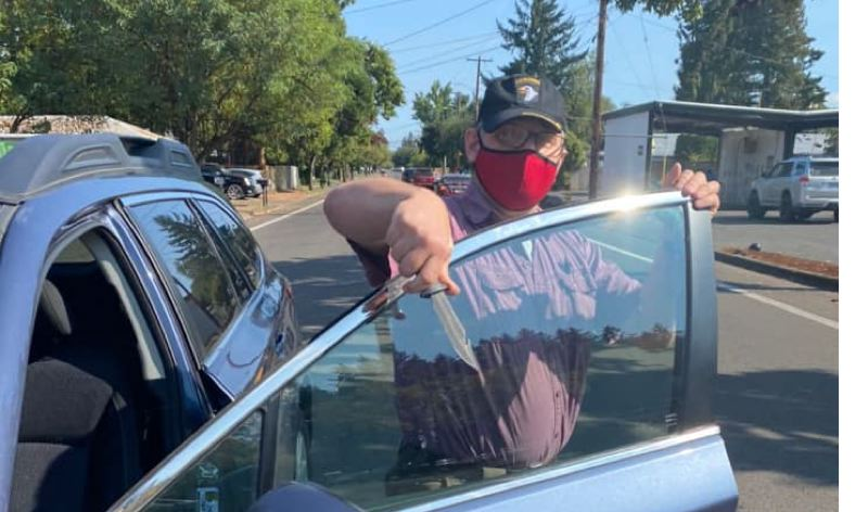 COURTESY: JANIRA BRANNIGAN - A man with a knife was arrested after an altercation broke out at an Oregon Women for Trump rally in Hillsboro on Sunday, Oct. 4.
