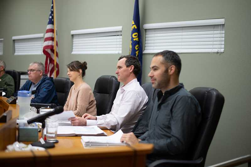PMG PHOTO: ANNA DEL SAVIO - Scappoose City Councilors listen to a speaker at a March 2020 meeting.