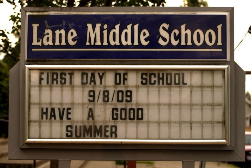FILE - A sign board at Lane Middle School announces the first day of school on Sept. 8th in 2009.