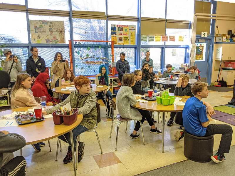 PMG FILE PHOTO - Students at Bridger K-8 School in Portland listen to a presentation about clean energy in January 2020. The governor's office and state health officials say they're working to get students back in classrooms with revised health metrics amid the COVID-19 pandemic.