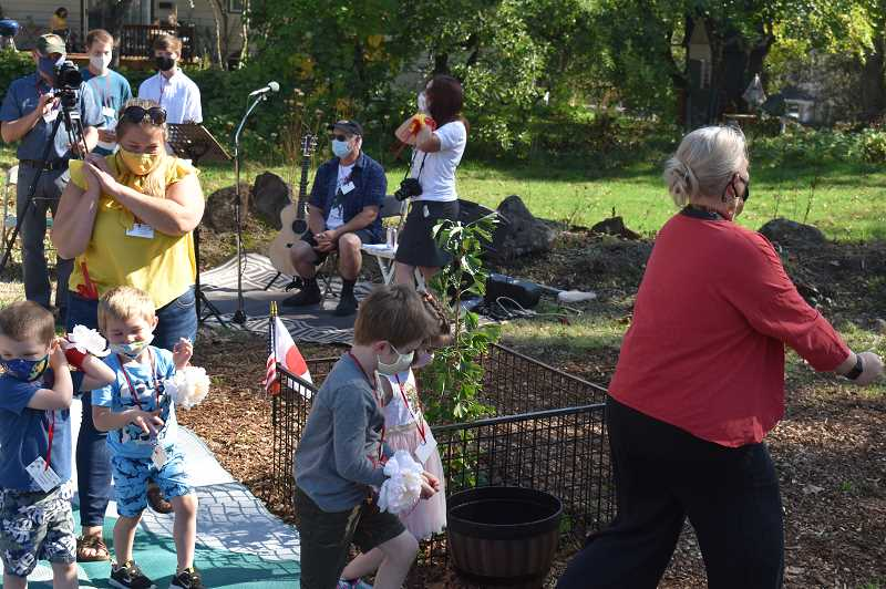 PMG PHOTO: RAYMOND RENDLEMAN - Gladstone children and parents perform a traditional Japanese coal-miner dance on Oct. 4.