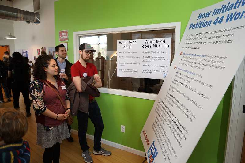PHOTO COURTESY OF YES ON IP 44 - Portland residents check out information about Initiative Petition 44, which will be on Novembers ballot as Measure 110, during a campaign launch event earlier this year.