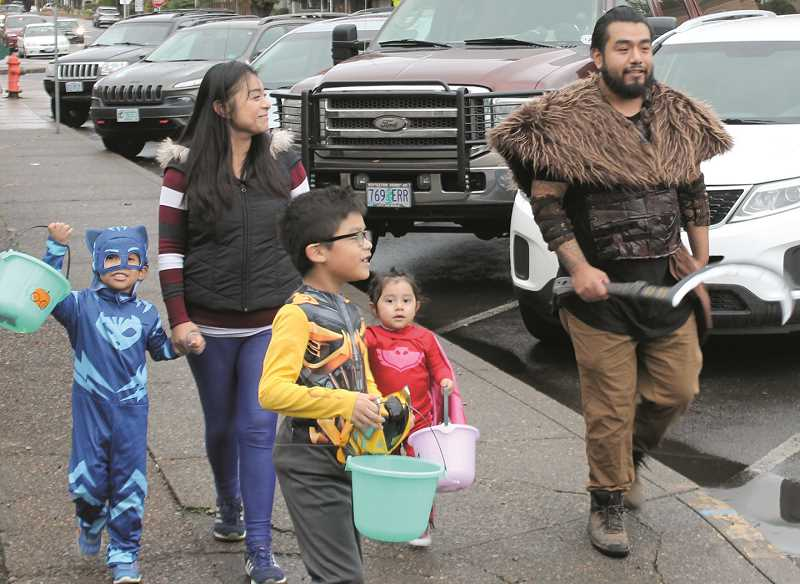 PMG FILE PHOTO - Trick-or-treaters flood Canby's downtown streets on Halloween in 2018. This year because of the pandemic, an alternative event is taking place at the fairgrounds.