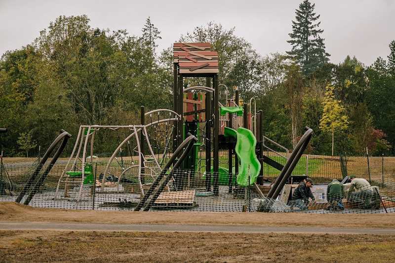PMG PHOTO: COLIN HYATT - Large, modern playground equipment is the centerpiece of Friends Park, one of CPRD's newest projects.