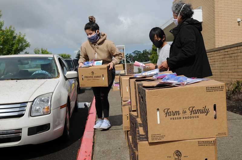 PMG FILE PHOTO - In addition to deliveries made to people's homes, families can pick up food for their students twice a week at Newberg High School.
