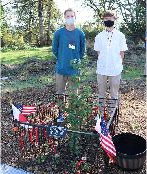 COURTESY PHOTO - Gladstone High School student Ryan Lee served as Master of Ceremonies at the event, and Ayden Brogden assisted with tying peace coins and wishes to the tree, a Japanese cultural tradition associated with the tanabata festival.