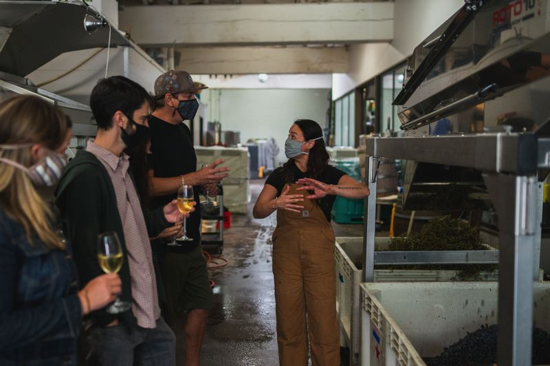 COURTESY PHOTO - Kate Norris explains the winemaking process to visitors at SE Wine Collective.
