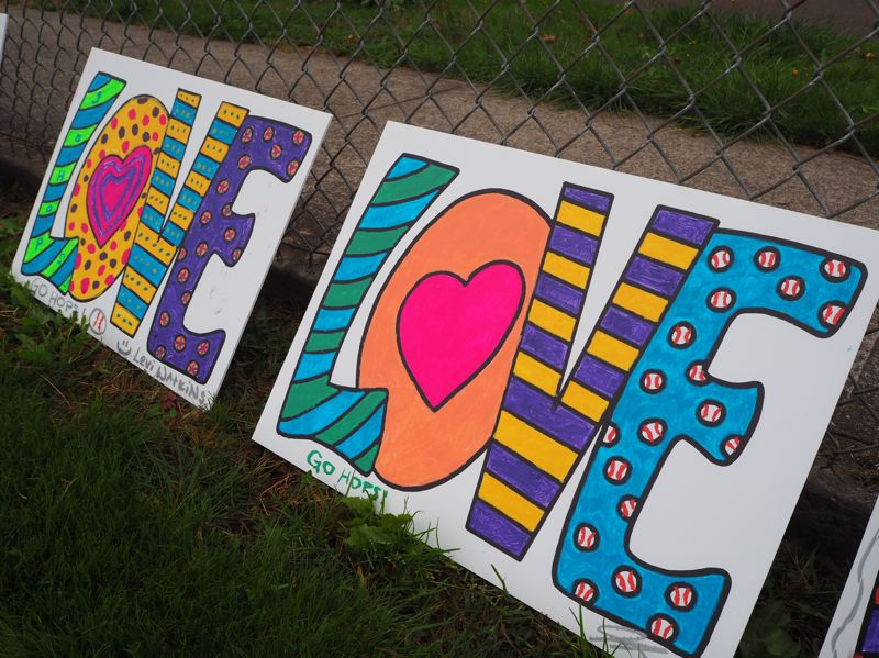 PMG PHOTO: MAX EGENER - 'Love' signs created by Hillsboro Hops staff as part of 'LOVE on the FENCE.'