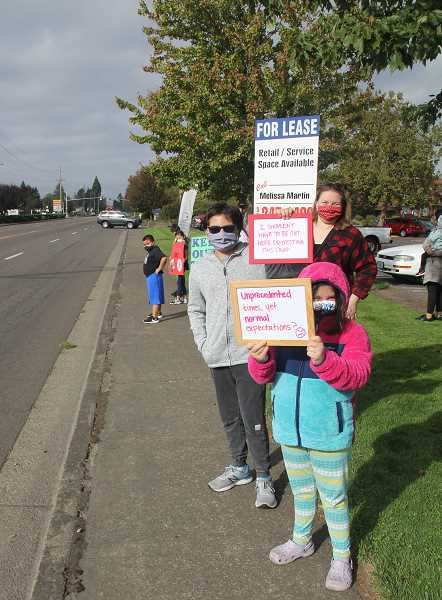 PMG PHOTO: JUSTIN MUCH - Woodburn Education Association members were joined by students on Friday, Oct. 9, as they staged a rally and motorcade through Woodburn to underscore safety concerns amid the COVID-19 pandemic.