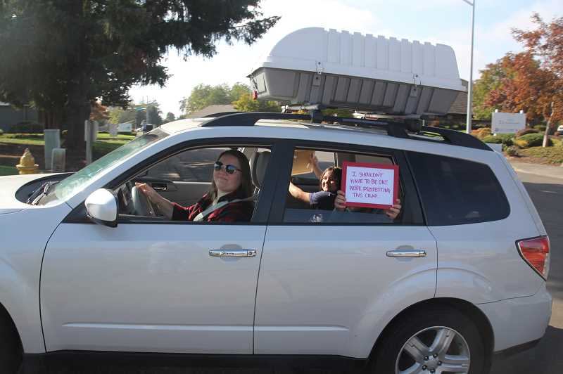 PMG PHOTO: JUSTIN MUCH - Woodburn Education Association members and some Woodburn School District students took part in a motor rally through downtown Woodburn and Settlemier Avenue before ending at the district offices.