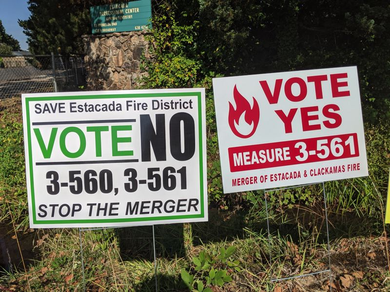 PMG PHOTO: EMILY LINDSTRAND - Signs supporting and opposing a merger of Estacada and Clackamas Fire Districts can be found in downtown Estacada.