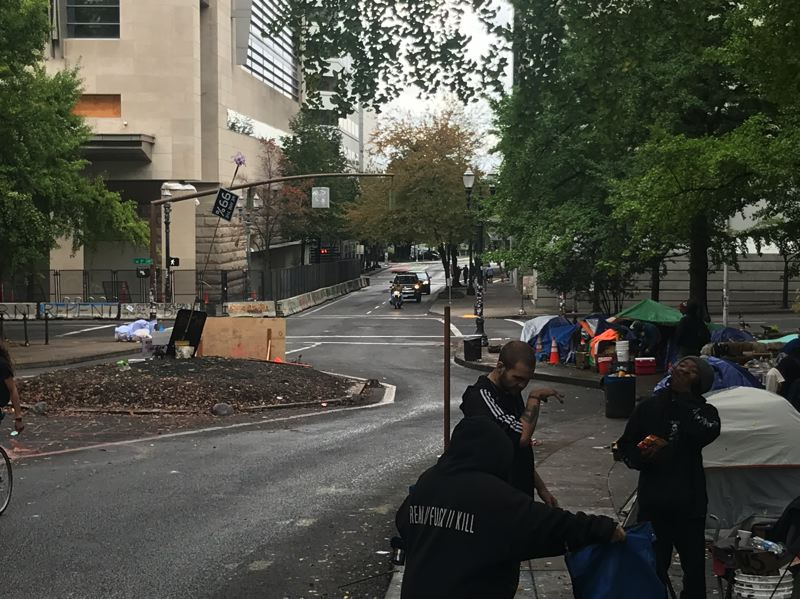 PMG PHOTO: ZANE SPARLING - Two elk statues have watched over a traffic island on Southwest Main Street at Third Avenue, but as of Friday, Oct. 10, both have vanished.