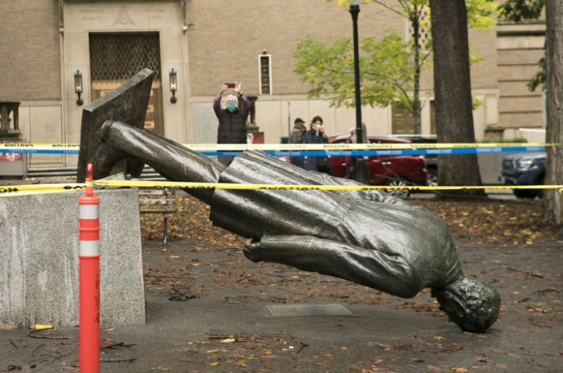 OMG PHOTO: JAIME VALDEZ - A statue of Abraham Lincoln was toppled during a riot in Portland's South Park Blocks late Sunday, Oct. 11. The night of violence has drawn condemnation from all sides.