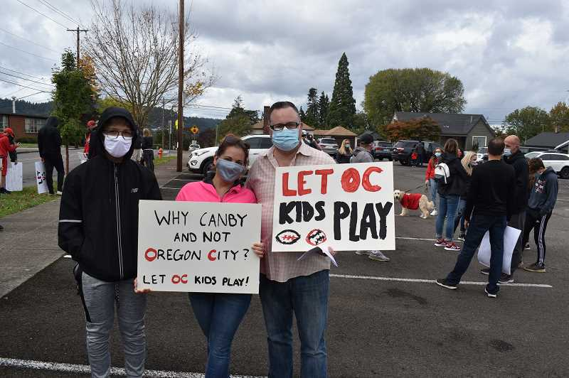PMG PHOTO: RAYMOND RENDLEMAN - Oregon City High School sophomore Parker Bolinger, Leah Ringo-Bailey and Troy Bolinger appeared at the Oct. 10 rally.