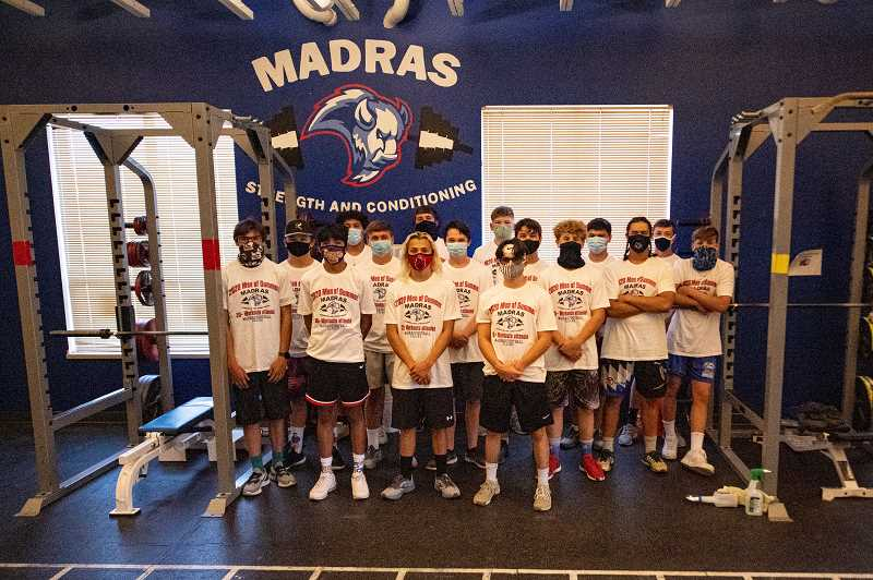 LON AUSTIN  - Madras High football players display their 'Men of Summer' t-shirts, honors for consistently making practice and weight-training sessions even though the fall season didn't happen.