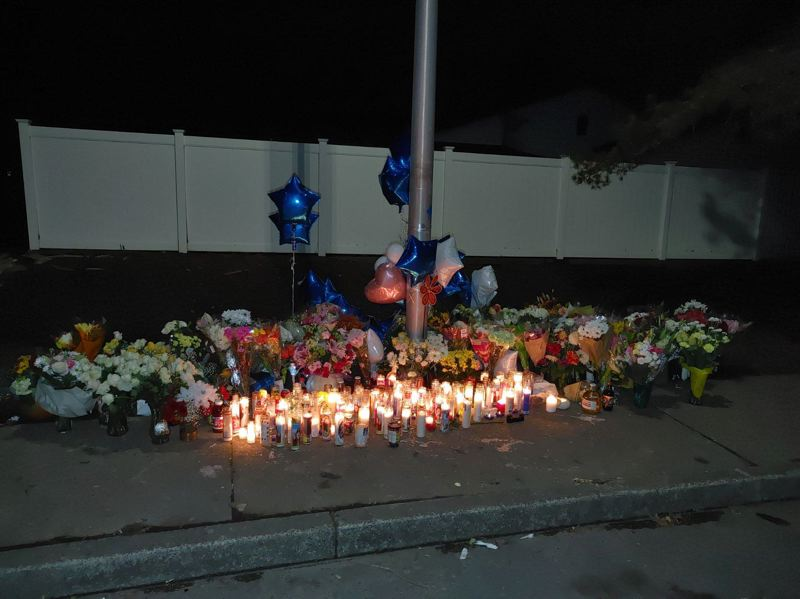 COURTESY PHOTO: - A memorial set up at Northeast Barberry Drive in Hillsboro where 17-year-old Adrian Bucio-Rodriguez was shot and killed Friday, Oct. 9.