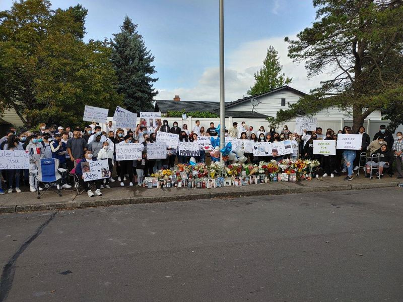 COURTESY PHOTO: - Family and friends gather Tuesday, Oct. 13 around a memorial in Hillsboro where 17-year-old Adrian Bucio-Rodriguez was shot and killed days earlier.