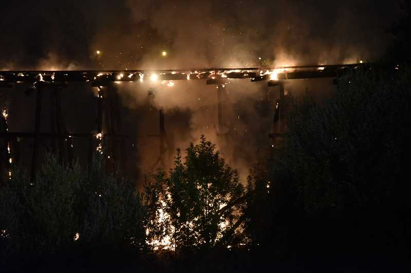 COURTESY PHOTO: TVF&R - The train trestle that burned in Sherwood on Aug. 10, 2015, collapsed in the early-morning hours of Aug. 11. The trestle will be included in a Nov. 8 Weather Channel segment of Weather Gone Viral.
