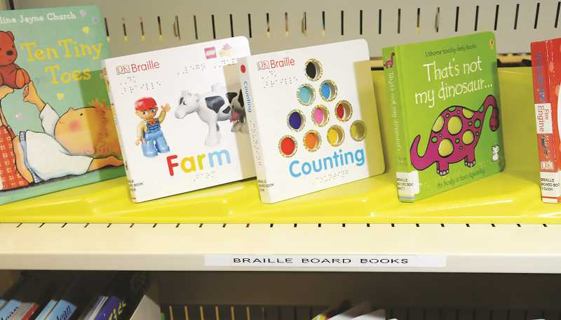 PMG PHOTO: GARY ALLEN - The section for visually impaired folks includes books for children as well.