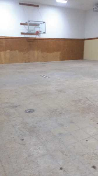 PMG PHOTO: SANDY STOREY - Molalla Nazarene's multi-purpose floor was inundated with ash and gunk, necessitating replacement as well.