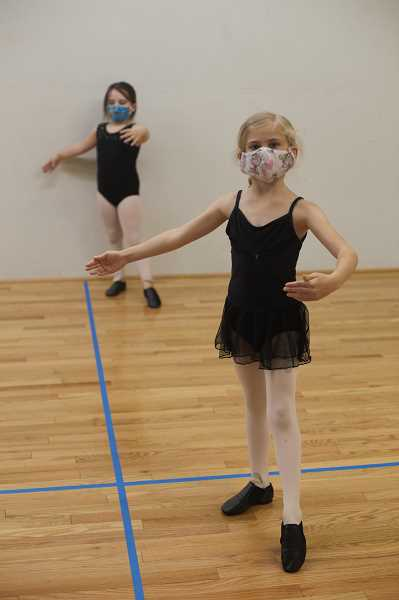 COURTESY PHOTO: ENCORE PERFORMING ARTS CENTER - Two children seen practicing ballet with masks on at the Encore Performing Arts Center in Beaverton. The center is requiring students and staff to wear masks while in the building due to the coronavirus pandemic.