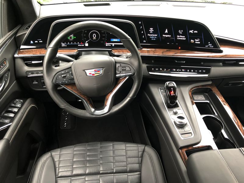 PMG PHOTO: JEFF ZURSCHMEIDE - When you settle into the front seats of the Escalade, the presentation looks like something out of Star Trek. The dashboard screen with the infotainment, navigation, and vehicle settings is curved, which is an industry first.