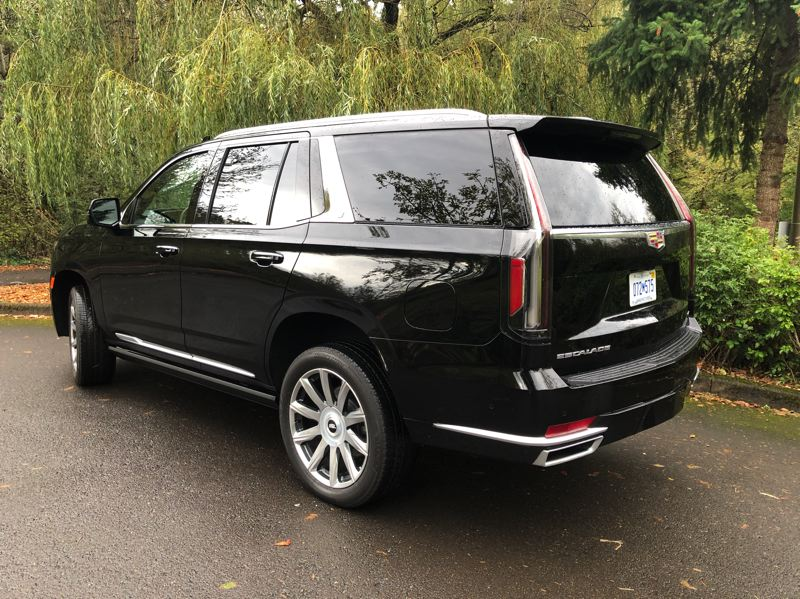 PMG PHOTO: JEFF ZURSCHMEIDE - On the road, the Escalade feels solid and offers unshakeable traction, largelydue to a new design independent rear suspension.