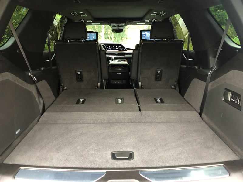 PMG PHOTO: JEFF ZURSCHMEIDE - Cadillac has increased the third-row legroom by 10 inches. All the seats fold down to create a huge cargo space when you need it.