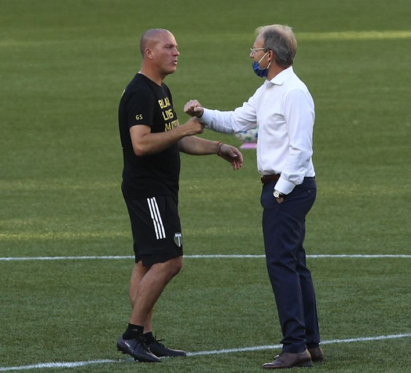 PMG PHOTO: JAIME VALDEZ - Timbers coach Giovanni Savarese (left) and Seattle Sounders coach Brian Schmetzer, pictured before an August match, will square off again Thursday with first place on the line.
