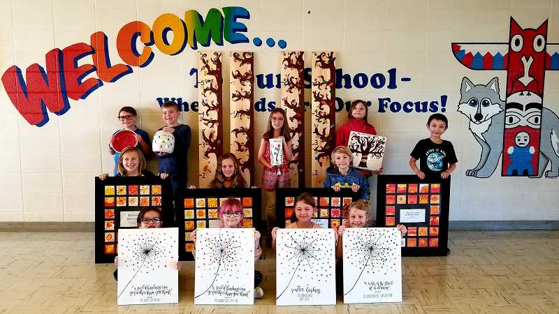 COURTESY OF GRANT WATTS PARENT ORGANIZATION - Students at Grant Watts Elementary School pose with their class projects, which were auctioned off in April.