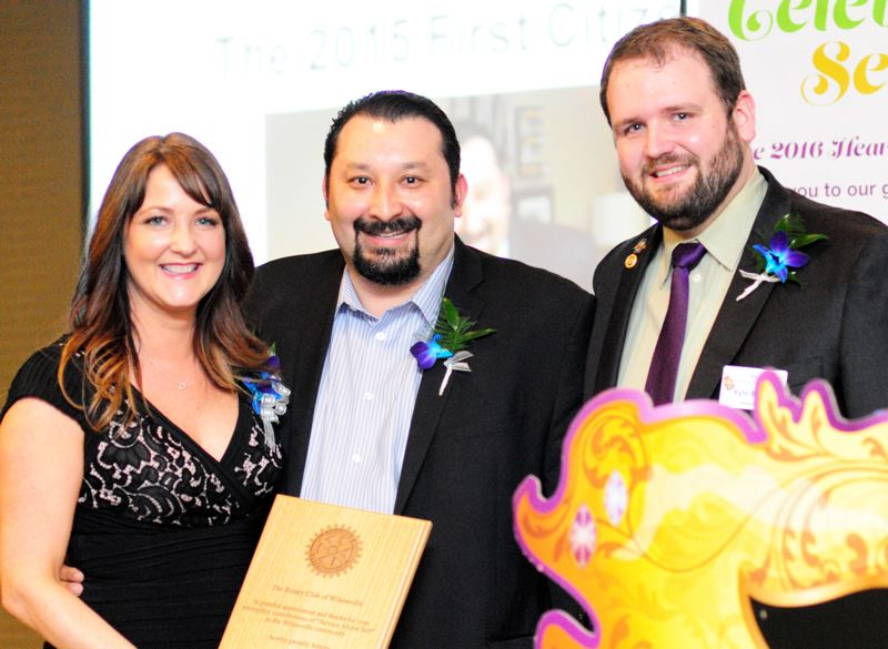 PMG FILE PHOTO - Sherine and Jaimy Beltran, left and center, were presented the First Citizen award by former Rotary Club of Wilsonville President Kyle Bunch, right, at the Heart of Gold Dinner and Auction in 2016.