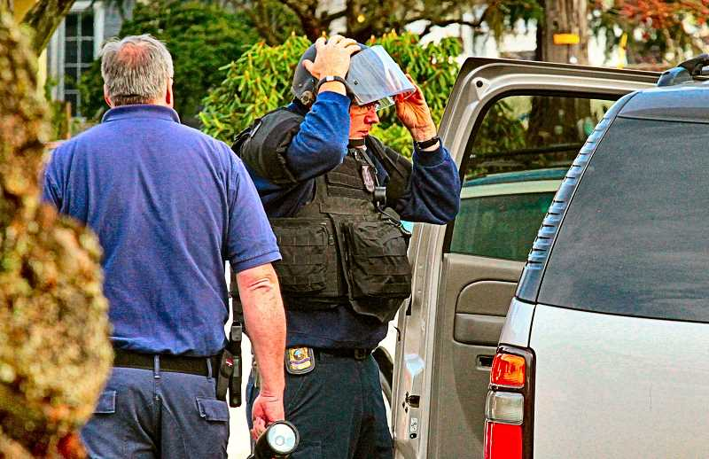 DAVID F. ASHTON - A Portland Police Explosive Disposal Unit member suited-up before investigating an explosive device, which looked like a pipe bomb, in Woodstock.