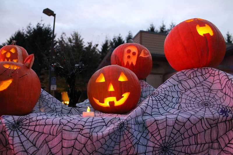 PMG PHOTO: HOLLY BARTHOLOMEW - Community-carved pumpkins lined the Boo Drive Thru at the West Linn Adult Community Center Saturday, Oct. 17.