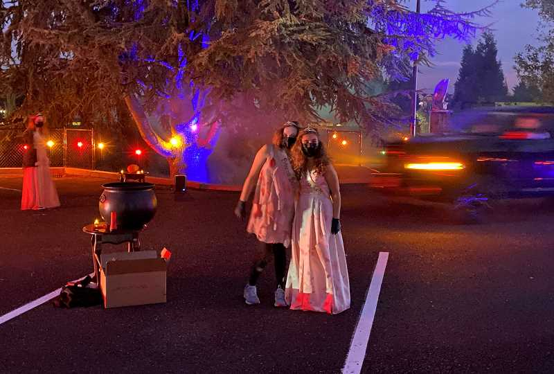PMG PHOTO: HOLLY BARTHOLOMEW - Old Time Fair Court members, AKA zombie princesses passesd out goody bags at the Boo Drive Thru.