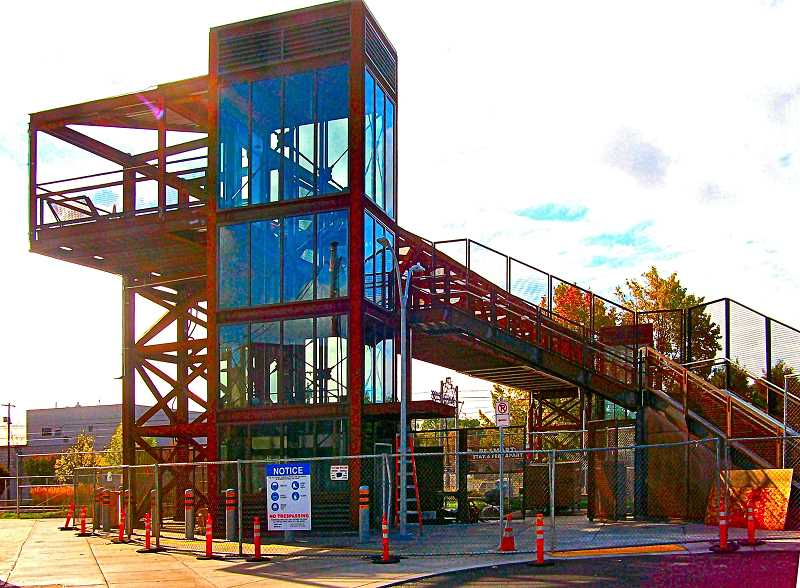 RITA A. LEONARD - The north entrance to the newly-completed Gideon Street rail overcrossing boasts a new plaza, seen at left, in addition to the stairway at right.