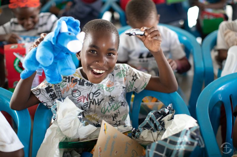 COURTESY PHOTO: SAMARITAN'S PURSE - A child from Botswana is excited about the items in his shoebox from Operation Christmas Child.