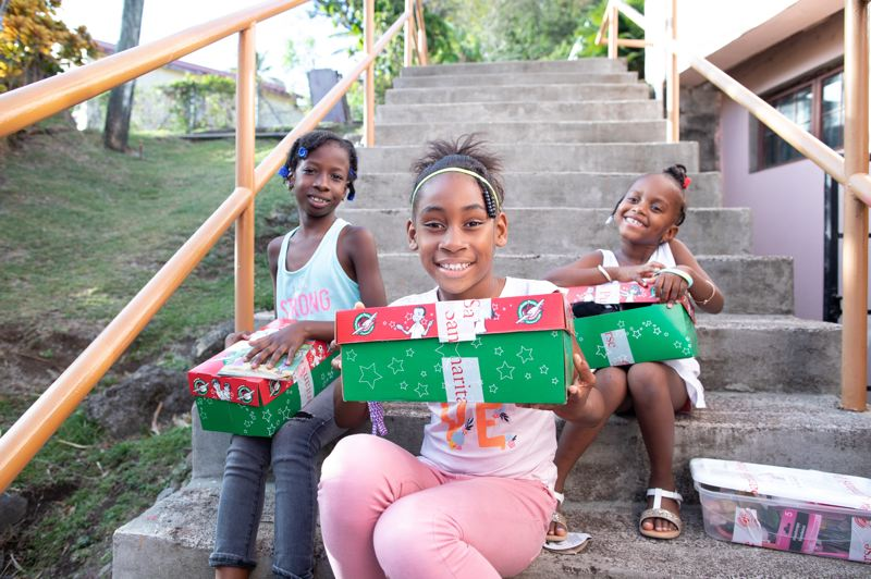 COURTESY PHOTO: SAMARITAN'S PURSE - Children in Granada are all smiles as they prepare to open shoe boxes from Operation Christmas Child.