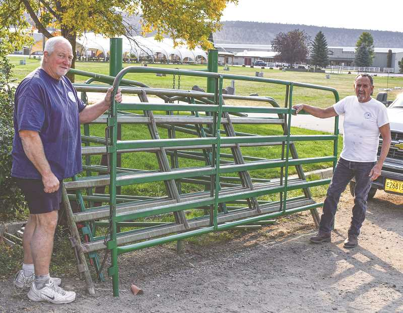 RAMONA MCCALLISTER - Ron Marston, left, and Jim Crittenden standing next to a refurbished livestock panel for the Crook County Fairgrounds. Both of the volunteers have a background in fabrication and have done a number of large projects on the fairgrounds property, including gates, signs, stairs, tables and bull chutes.