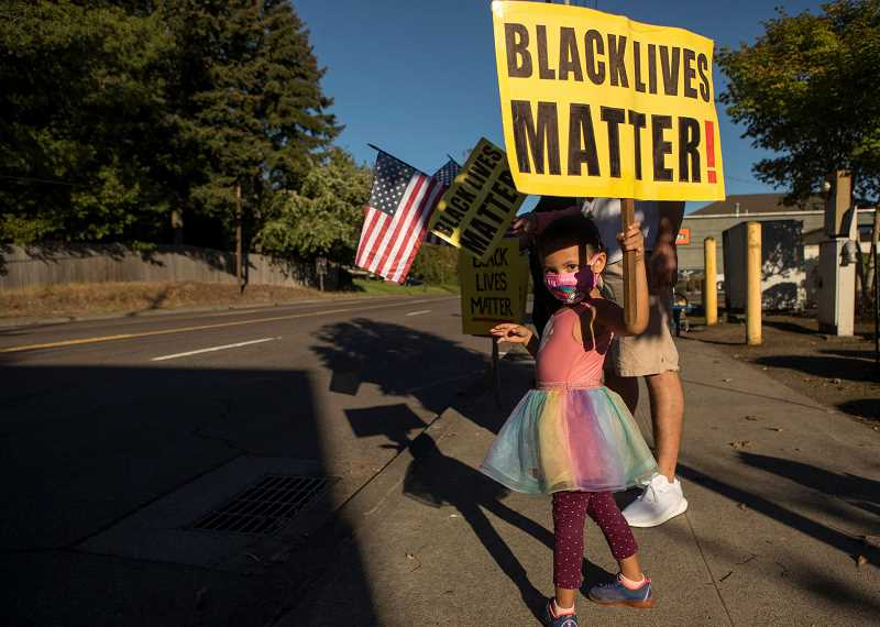 PMG FILE PHOTO - Mariah Domond, 3, holds a Black Lives Matter sign during a BLM vigil along Beaverton-Hillsdale Highway last month. The Beaverton School District stands with the statement and will allow staff to display it either physically or virtually.