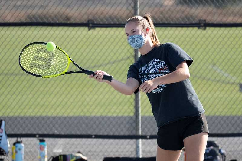 LON AUSTIN - Ashley Barker keeps her focus on her forehand during a Cowgirls' doubles match with Ridgeview earlier this month. Barker and teammate Lillian Hoffman took the only victory for Crook County during the Oct. 6 match against Ridgeview.
