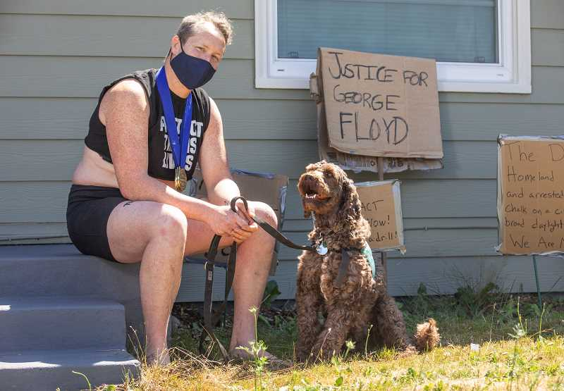 PMG PHOTO: JONATHAN HOUSE - Juniper Simonis, pictured here in July with their service dog Wallace, talks about the post-arrest conditions while incarcerated for protesting. Simonis is now spearheading a weapons research effort focused on the toxicity of chemical agents used by local and federal police during Black Lives Matter protests.