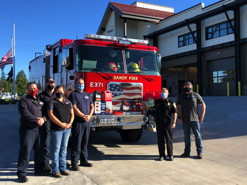 COURTESY PHOTO: SANDY FIRE DISTRICT - Tractor Supply donated four chainsaws and gift cards for $1,500 on Monday, Sept. 28.