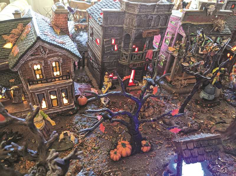 PMG PHOTO: JOHN BAKER - A close look at one of the many villages that make up the Halloween collection on display from a Canby couple.