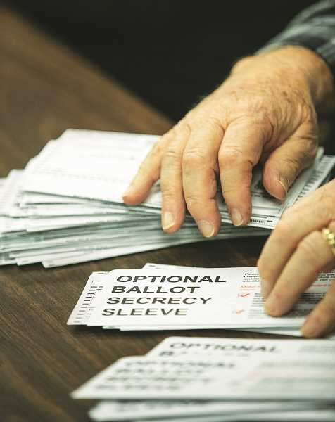 Voters flock to submit ballots after receiving them in the mail