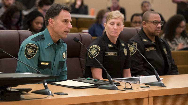 PMG FILE PHOTO - Multnomah County Sheriff Mike Reese, left, testifies in 2018. A proposal being floated would have his office take over policing duties from the Portland Police Bureau.