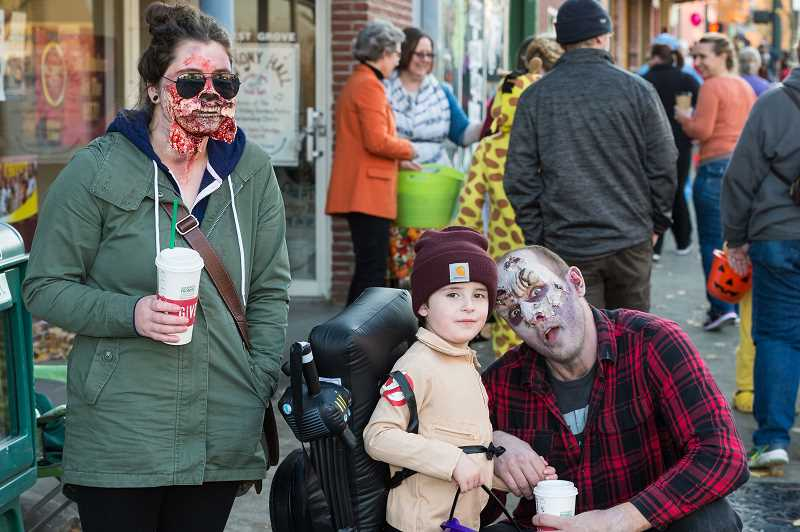 PMG FILE PHOTO - Kids of all ages walked the sidewalks in downtown Forest Grove to trick-or-treat the local merchants in years past.