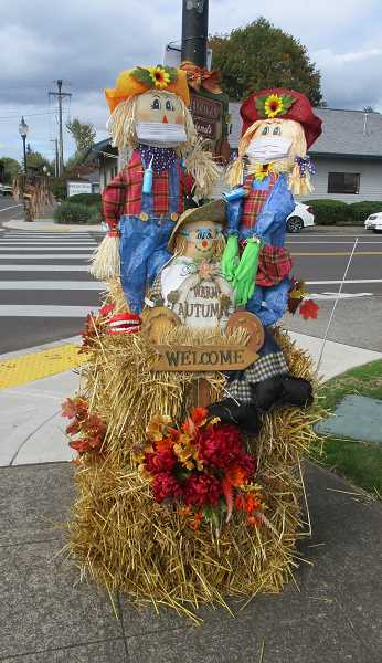 PMG PHOTO: DEBORAH GUINTHER - Autumn cuteness abounds in Canby's downtown during the annual Scarecrow Contest.