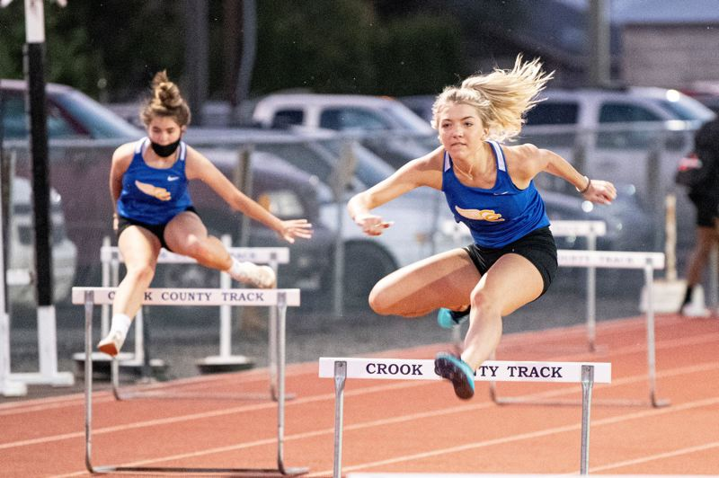 PMG PHOTO: LON AUSTIN - Crook County's Eliot Moore clears a hurdle during the 100-meter high hurdles against Culver at Crook County High School Oct. 1.