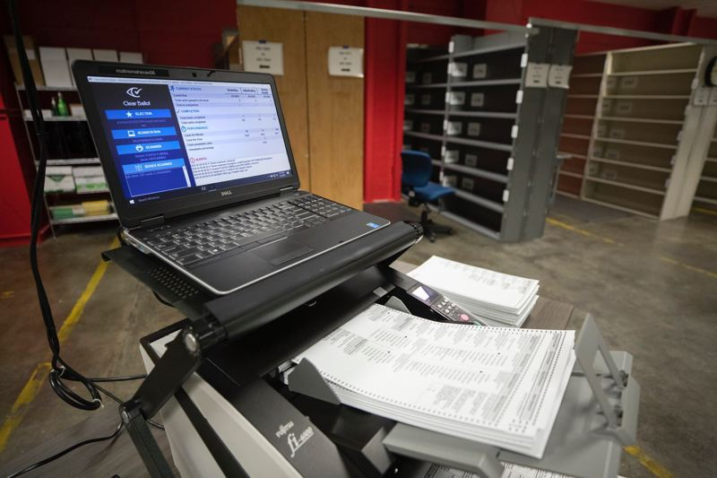 PMG PHOTO: JONATHAN HOUSE - A computer attached to a scanner gives the results of a sample ballot test at the Multnomah County Elections Office prior to the May primary election.